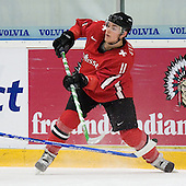 Janick Steinmann (EV Zug - Switzerland) passes the puck. The Suisse defeated Slovakia 2-1 in a 2007 World Juniors match on January 2, 2007, at FM Mattson Arena in Mora, Sweden.