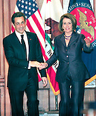 Washington, D.C. - March 30, 2010 -- President Nicolas Sarkozy of France walks towards the guest book with the Speaker of the United States House of Representatives Nancy Pelosi (Democrat of California) as he arrives for a visit in the U.S. Capitol on Tuesday, March 30, 2010..Credit: Ron Sachs / CNPWashington, D.C. - March 30, 2010 -- President Nicolas Sarkozy of France visits the Speaker of the United States House of Representatives Nancy Pelosi (Democrat of California) in the U.S. Capitol on Tuesday, March 30, 2010..Credit: Ron Sachs / CNP