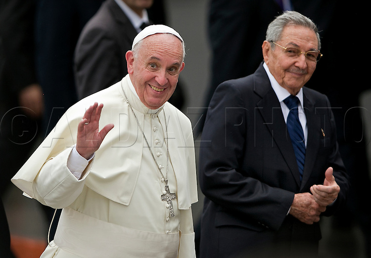 Pope Francis arrives at the Jose Marti International Airport as he is greeted by Cuban President Raul Castro in Havana, Cuba on Saturday, September 19, 2015.