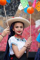 Girls wearing traditional Mexican costumes, Northwest Folklife Festival 2016, Seattle Center, Washington, USA.