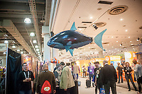 """A helium-filled remote controlled """"Air Swimmers"""" Great White Shark floats above the William Mark Corp. booth at the 111th American International Toy Fair in the Jacob Javits Convention center in New York on Monday, February 17, 2014.  The four day trade show with over 1000 exhibitors connects buyers and sellers and is expected to draw tens of thousands of attendees.  The toy industry generates  $22 billion in the United States and Toy Fair is the largest toy trade show in the Western Hemisphere. (© Richard B. Levine)"""