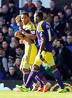 Pictured: Jonathan de Guzman of Swansea (C) with team mates Jose Canas (L) and Dwight Tiendalli (R) celebrating his equaliser making the score 1-1. Sunday 16 February 2014<br />