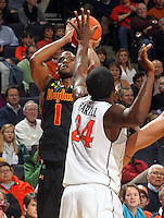 Jan. 27, 2011; Charlottesville, VA, USA; Maryland Terrapins guard Adrian Bowie (1) shoots over Virginia Cavaliers guard K.T. Harrell (24) during the game at the John Paul Jones Arena. Mandatory Credit: Andrew Shurtleff