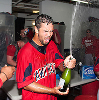 Pawtucket Red Sox starting pitcher Nelson Figueroa #38 celebrates in the locker room after game four of a best of five playoff series against the Empire State Yankees at Frontier Field on September 8, 2012 in Rochester, New York.  Pawtucket defeated Empire State 7-1 behind Figueroa who went eight innings allowing only two hits and one run to advance to the International League Finals.  (Mike Janes/Four Seam Images)