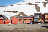 SVALBARD, Longyearban, A family cycling down one of the main streets