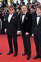 "CANNES, FRANCE. May 16, 2019: Sir Elton John, David Furnish & Kit Connor at the gala premiere for ""Rocketman"" at the Festival de Cannes.<br /> Picture: Paul Smith / Featureflash"