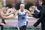 Brooke Stevens (8) of the High Point Panthers high fives her teammates during player introductions prior to the match against the North Carolina Tar Heels at Vert Track, Soccer & Lacrosse Stadium on February 16, 2018 in High Point, North Carolina.  The Tar Heels defeated the Panthers 14-10.  (Brian Westerholt/Sports On Film)