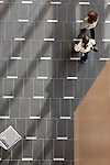 Students walks across tile floor on the campus of the University of Rhode Island. (Photo/Joe Giblin)
