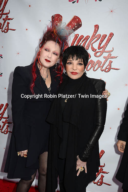 "Cyndi Lauper and Liza Minnelli arrives at the ""Kinky Boots"" Broadway Opening on April 4, 2013 at The Al Hirschfeld Theatre in New York City. Harvey Fierstein wrote is the Book Writer and Cnydi Lauper is the Composer."