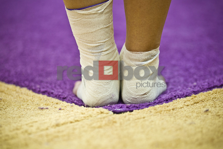 Closeup, detail, floor exercise, feet..Washington Huskies gymnastics vs. the UCLA Bruins at Alaska Airlines Arena at Hec Edmundson Pavilion in Seattle on Friday, January 27, 2012. (Photo by Dan DeLong/Red Box Pictures)