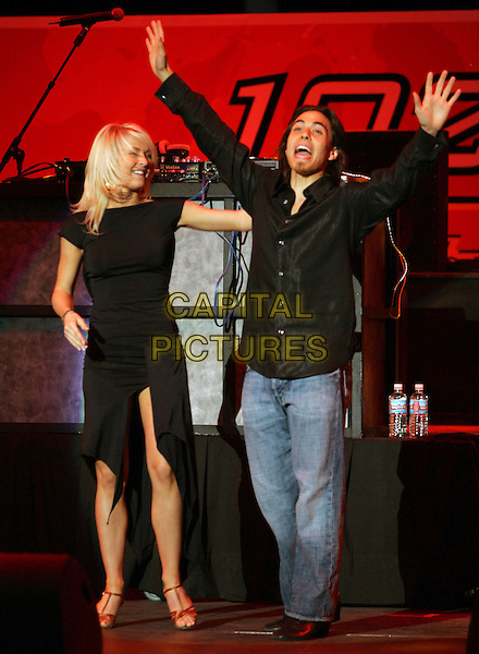 APOLO ANTON & JULIANNE HOUGH.At The 10th Annual KIIS FM Wango Tango 2007 held at Verizon Wireless Ampitheatre in Irvine, California, USA..May 12th, 2007.full length jeans denim gesture black dress shirt arms in air .CAP/DVS.©Debbie VanStory/Capital Pictures