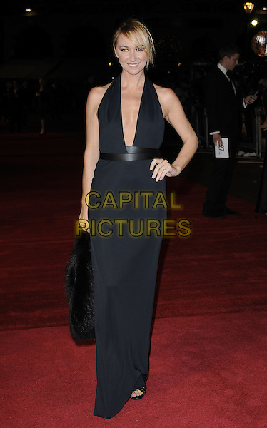 """FRIDA GIANNINI.The European Premiere of """"127 Hours"""" during the closing gala of the 54th BFI London Film Festival, Odeon Leicester Square, London. .28th October 2010 .LFF full length Gucci black low cut halterneck dress plunging neckline maxi open toe shoes sandals hand on hip.CAP/CAN.©Can Nguyen/Capital Pictures."""