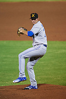 Salt River Rafters pitcher Justin Shafer (27) delivers a pitch during an Arizona Fall League game against the Scottsdale Scorpions on October 14, 2015 at Scottsdale Stadium in Scottsdale, Arizona.  Scottsdale defeated Salt River 13-3.  (Mike Janes/Four Seam Images)