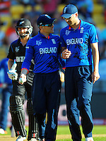 England captain Eoin Morgan talks to James Anderson during the ICC Cricket World Cup one day pool match between the New Zealand Black Caps and England at Wellington Regional Stadium, Wellington, New Zealand on Friday, 20 February 2015. Photo: Dave Lintott / lintottphoto.co.nz