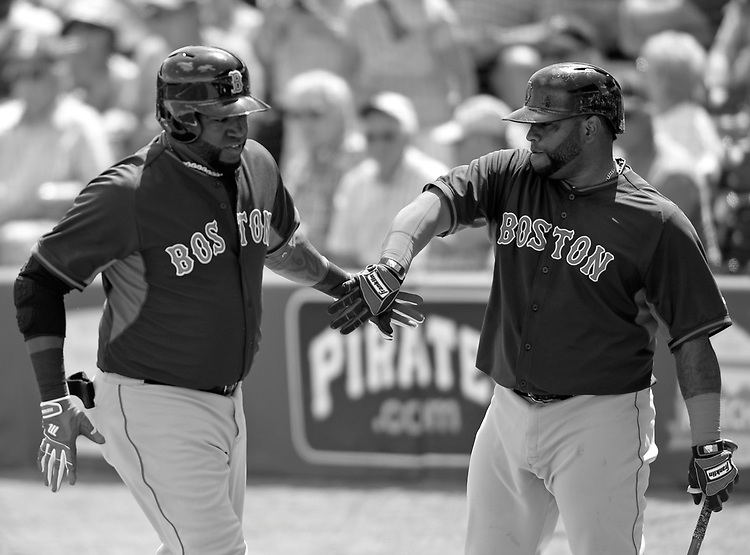 (Bradenton, FL, 03/12/15) Boston Red Sox designated hitter David Ortiz, left, is congratulated by teammate Pablo Sandoval after Ortiz hit a three-run homer against the Pittsburgh Pirates during the third inning of a Major League Baseball spring training baseball game at McKechnie Field in Bradenton, Florida on Thursday, March 12, 2015. Photo by Christopher Evans