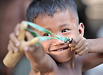 A boy with a slingshot in the Cambodian village of Char.