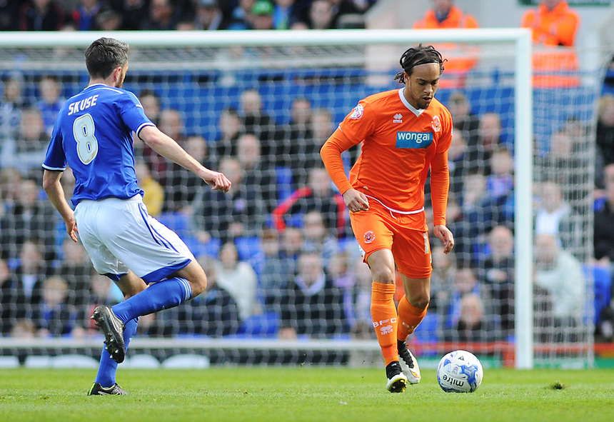 Blackpool's Charles Dunne under pressure from Ipswich Town's Cole Skuse<br /> <br /> Photographer Kevin Barnes/CameraSport<br /> <br /> Football - The Football League Sky Bet Championship - Ipswich Town v  Blackpool - Saturday 11th April 2015 - Portman Road - Ipswich<br /> <br /> &copy; CameraSport - 43 Linden Ave. Countesthorpe. Leicester. England. LE8 5PG - Tel: +44 (0) 116 277 4147 - admin@camerasport.com - www.camerasport.com