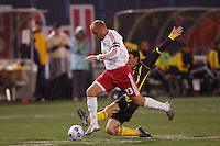 Columbus Crew forward (3) Brad Evans attempts a tackle on NY Red Bulls midfielder (13) Clint Mathis at Giants Stadium, East Rutherford, NJ, on May 19, 2007. The Red Bulls defeated the Crew 4-0.