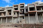 Concrete shells of uncompleted housing in the Castillo development, Caleta de Fuste,  Fuerteventura, Canary Islands, Spain
