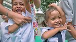 Children in the Manila North Cemetery in Manila, Philippines, sing a song that includes tickling their armpits on January 16, 2018.  The children participate in classes sponsored by the United Methodist Women-supported Kapatiran-Kaunlaran Foundation (KKFI), which carries out educational and other work in the cemetery.