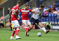 Bolton Wanderers' Yanic Wildschut competing with Bristol City's Marley Watkins<br /> <br /> Photographer Andrew Kearns/CameraSport<br /> <br /> The EFL Sky Bet Championship - Bolton Wanderers v Bristol City - Saturday August 11th 2018 - University of Bolton Stadium - Bolton<br /> <br /> World Copyright &copy; 2018 CameraSport. All rights reserved. 43 Linden Ave. Countesthorpe. Leicester. England. LE8 5PG - Tel: +44 (0) 116 277 4147 - admin@camerasport.com - www.camerasport.com