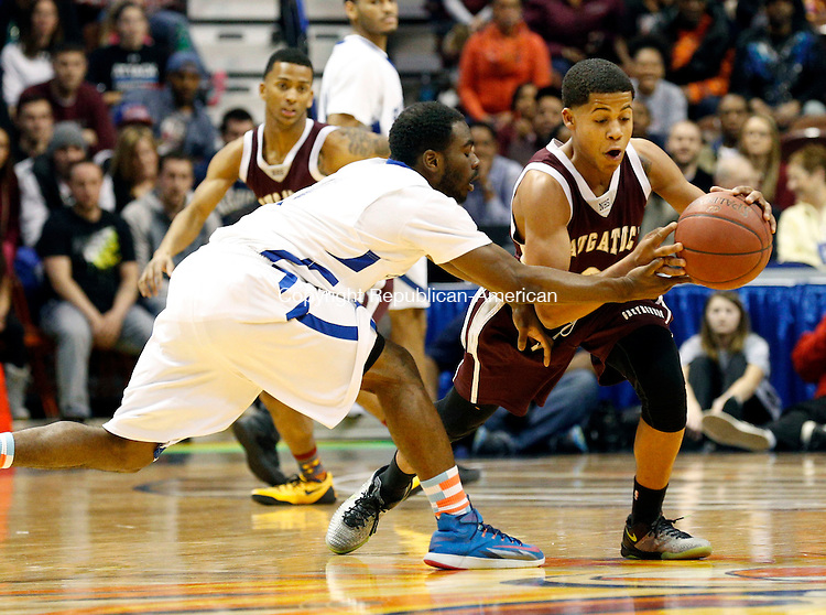 Uncasville, CT- 22 March 2015-032215CM03- Naugatuck's Dayvon Russell makes a steal against Buennell's Ryan Pittman during their first half matchup in the Class L state championship game at Mohegan Sun Arena in Uncasville on Sunday.    Christopher Massa Republican-American