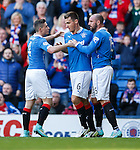 Lee McCulloch celebrates his goal with Kris Boyd and Fraser Aird