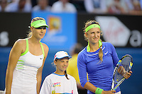MELBOURNE, 28 JANUARY - Victoria Azarenka (BLR) and Maria Sharapova (RUS) pose for pictures at the women's finals match on day thirteen of the 2012 Australian Open at Melbourne Park, Australia. (Photo Sydney Low / syd-low.com)