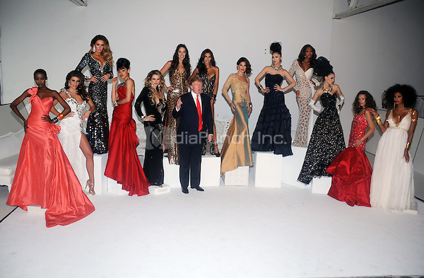 Donald Trump attends the Miss Universe photocall with previous and current winner at Chelsea Piers, Studio 59 on July 27, 2011 in New York City © mpi01 / MediaPunch Inc.