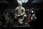 XIAN, CHINA - JUNE 3: Unidentified Chinese tourists look at a statue during a visit the Terracotta museum on June 3, 2007 in central Xian, China. The museum shows the 2200-year old life size terracotta figures. Xian has about 3,3 million inhabitants and is the capital of Shaanxi province in China. It was the eastern terminus for the Silk Road and the location for the Terracotta Army during the Qin Dynasty. Its history dates back more than 3,100 years.  (Photo by Per-Anders Pettersson)..