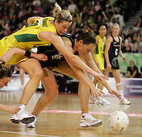 21.07.2007 Silver Ferns Jodi Te Huna and Australian Julie Prendergast in action during the Silver Ferns v Australia Netball Test Match at Vodafone Arena, Melbourne Australia. The Silver Ferns won 67-65 after double extra time. Mandatory Photo Credit ©Michael Bradley. **$150 + GST USAGE FEE DOES APPLY**