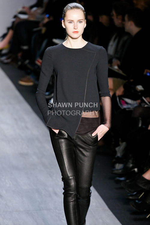 Lisanne De Jong walks the runway in a black crepe and mesh top, black leather pant, and black platform boot, by designer Max Azria for the Max Azria Fall 2010 collection fashion show, during Mercedes-Benz Fashion Week Fall 2010.