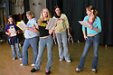 Middle school girls in rehearsal for a play; they are participants in an after-school drama program of Seattle's Arts Corps organization.