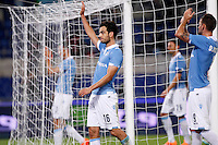 Calcio, Serie A: Lazio vs Torino. Roma, stadio Olimpico, 26 ottobre 2014.<br /> Lazio's Marco Parolo, left, Filip Djordjevic, right, and their teammates greet fans at the end of the Italian Serie A football match between Lazio and Torino at Rome's Olympic stadium, 26 October 2014. Lazio won 2-1.<br /> UPDATE IMAGES PRESS/Isabella Bonotto