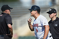 Kannapolis Intimidators manager Justin Jirschele (9) argues with home plate umpire Matt Baldwin after he reversed a call during the game against the Greensboro Grasshoppers at Kannapolis Intimidators Stadium on August 5, 2018 in Kannapolis, North Carolina. The Intimidators defeated the Grasshoppers 9-0 in game two of a double-header.  (Brian Westerholt/Four Seam Images)