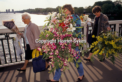 chelsea flowers show last day taking home flowers sold cheaply at te end of the show London Uk