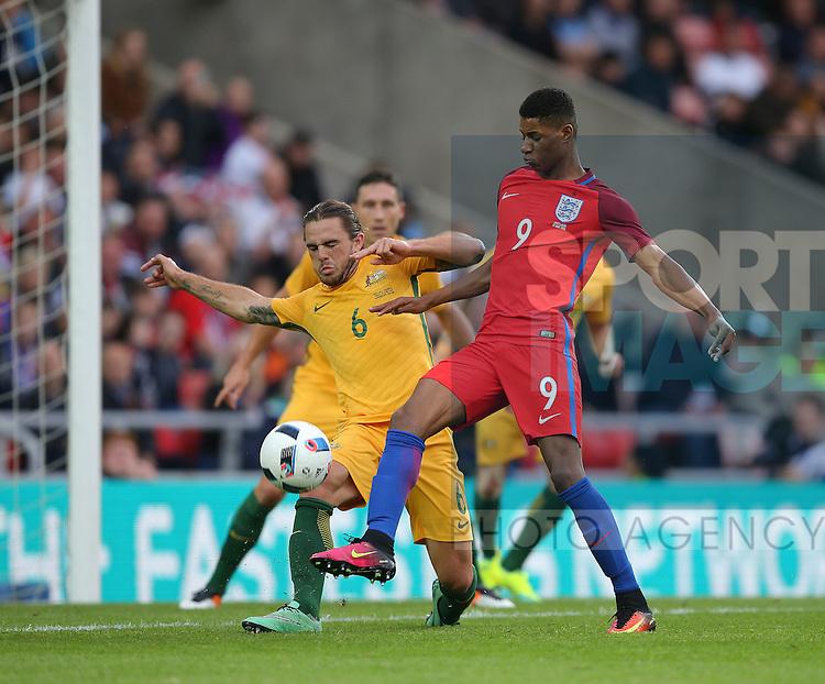 Joshua Risdon of Australia tackles Marcus Rashford of England during the International Friendly match at the Stadium of Light, Sunderland. Photo credit should read: Simon Bellis/Sportimage