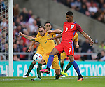 Joshua Risdon of Australia tackles Marcus Rashford of England during the International Friendly match at the Stadium of Light, Sunderland. Photo credit should read: Simon Bellis/Sportimage