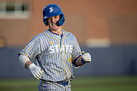 San Jose State Spartans outfielder Kellen Stahm (4) grimaces after getting hit by a pitch against the Michigan Wolverines on March 27, 2019 in Game 2 of the NCAA baseball doubleheader at Ray Fisher Stadium in Ann Arbor, Michigan. Michigan defeated San Jose State 3-0. (Andrew Woolley/Four Seam Images)