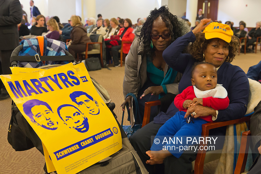 Feb. 25, 2013 - Mineola, New York, U.S. - SCOTTIE COADS, holding her 9-month-old grandson PARKER and wearing NAACP hat, and with MARTYRS poster. The legislature postponed the vote on the map shortly before 1 AM the morning of February 26, nearly 12 hours after the meeting started on 1:30 PM Feb. 25.