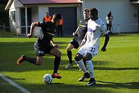 Mario Barcia tries to get round Joao Moreira (17, Auckland) during the Oceania Football Championship final (second leg) football match between Team Wellington and Auckland City FC at David Farrington Park in Wellington, New Zealand on Sunday, 7 May 2017. Photo: Dave Lintott / lintottphoto.co.nz