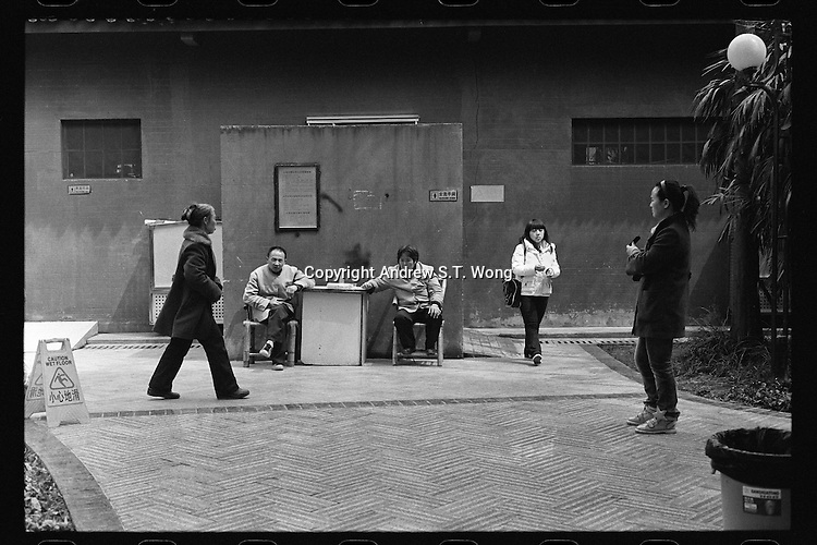 Chinese toilet attendants sit outside a public toilet at  the People's Park in Chengdu, capital city of the southwestern province of Sichuan, in March, 2011.