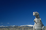 T Rex Roadside attraction, the worlds largest dinosaurs, Cabazon, California, west of Palm Springs, California State with San Bernadino Mountains in background