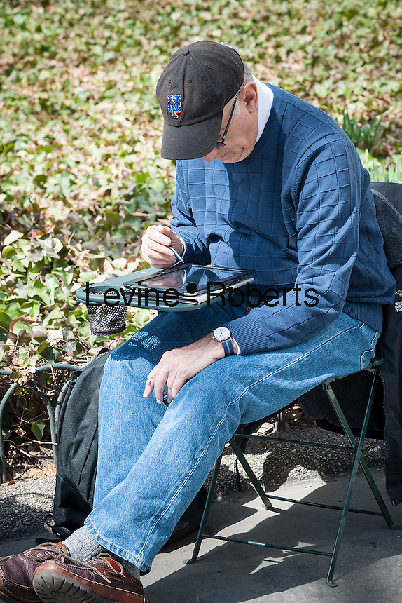 A visitor to Bryant Park in New York City with his tablet enjoys the warm weather during on Thursday, April 3, 2014.  Temperatures are expected to rise into the mid 60's with plenty of sun today and Friday but clouds and a chance of showers arrive over the weekend.  (© Richard B. Levine)