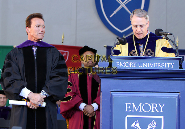 ARNOLD SCHWARZENEGGER & JIM WAGNER.California Governor and actor Arnold Schwarzenegger receives an honorary Doctorate of Laws Degree at Emory University Commencement with Arnold Schwarzenegger as the Keynote Speaker and honorary degree recipient.  , Atlanta, GA, USA..May 10th, 2010.half length cloak robe podium speech  black .CAP/ADM/DH.©Dan Harr/AdMedia/Capital Pictures.