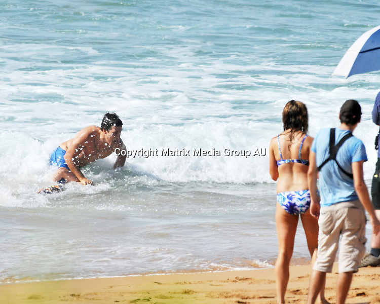 1 APRIL 2014 PALM BEACH AUSTRALIA<br /> <br /> EXCLUSIVE PICTURES<br /> <br /> Lincoln Younes pictured on set with English actor Hannah Britland shooting scenes at Palm Beach. Steve Peacock was also on set chasing Lincoln into the water.