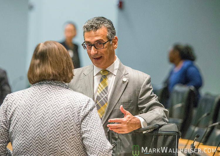 Representative Robert Asencio talks after the Health Quality subcommittee meetings in the Knott building at the Florida State Capitol in Tallahassee, Florida.
