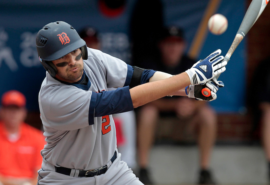 Bucknell infielder Rob Krentzman (23) hits the ball during the game against Virginia Friday at Davenport Field in Charlottesville, VA. Photo/The Daily Progress/Andrew Shurtleff