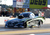 Sep 14, 2013; Charlotte, NC, USA; NHRA funny car driver Alexis DeJoria during qualifying for the Carolina Nationals at zMax Dragway. Mandatory Credit: Mark J. Rebilas-
