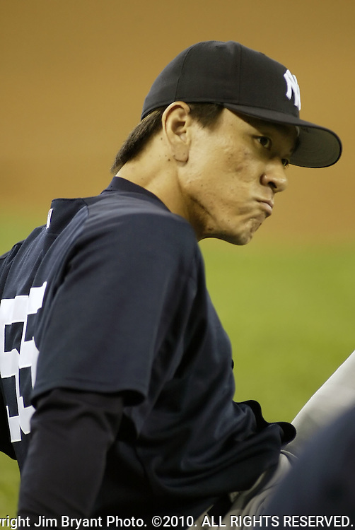 New York Yankees' Hideli Matsui makes a face while stretching out before their game against the Seattle Mariners in Seattle, Washington on Monday, 29 August, 2005. New York Yankees' Hideli Matsui warms up before their game against the Seattle Mariners in Seattle, Washington ALL RIGHTS RESERVED.